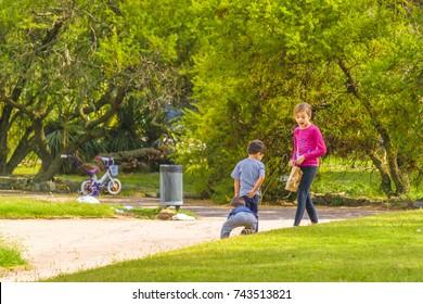 MONTEVIDEO, URUGUAY, MARCH - 2016 - Children at park in prado neighborhood in Montevideo, Uruguay