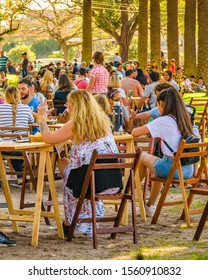 MONTEVIDEO, URUGUAY, NOVEMBER - 2019 - Crowd at outdoor bar enjoying a sunny sunday spring day at parque rodo park in montevideo city, uruguay