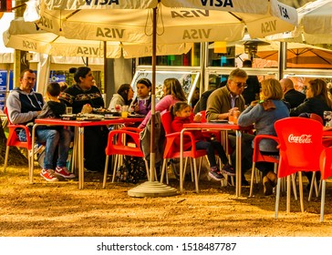 MONTEVIDEO, URUGUAY, SEPTEMBER - 2019 - People at rustic bar at traditional rural exhibition at prado neighborhood in montevideo city, uruguay