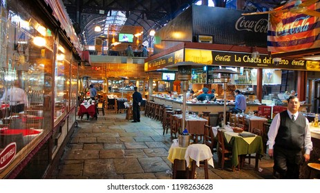 Montevideo, Uruguay-18 June, 2017: Famous Old Town Montevideo Port Market (Mercado Del Puerto) eateries serving famous national meat meals
