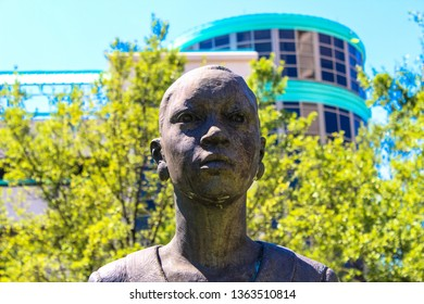 """Montgomery, AL - CIRCA 2019: Closeup of woman on """"Education"""" Monument Sculpture Statue in Downtown Montgomery, AL in the park across from the RSA Tower"""