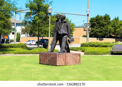 """Montgomery, AL - CIRCA 2019: """"Commerce"""" Monument Sculpture Statue in Downtown Montgomery, AL in the park across from the RSA Tower on a sunny day on Monroe St."""