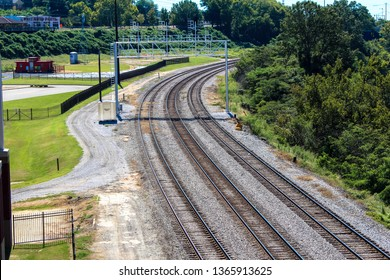 Montgomery, AL - CIRCA 2019: Curving railway train tracks in rural industrial part of downtown Montgomery, AL leading into Union Station near Alabama River waterfront