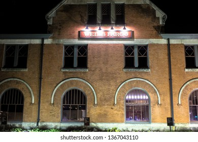 Montgomery, AL - CIRCA 2019: Night front view of Wells Fargo bank branch in downtown Montgomery, Alabama at the Union Station riverfront