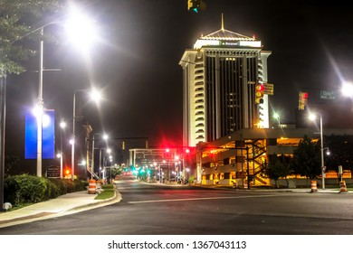 Montgomery, AL - CIRCA 2019: Night shot of illuminated street lights, parking structure and RSA tower on a corner in downtown Montgomery Alabama