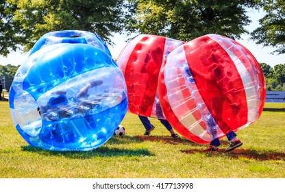 MONTGOMERY, ALABAMA - 7 MAY, 2016: Bubble Soccer Kids having an absolute blast playing Bubble during a local walkathon.