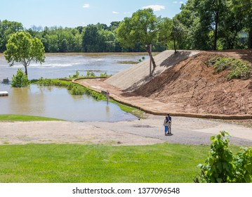 MONTGOMERY, ALABAMA - APRIL 20, 2019:  Couple Admiring The Alabama River:  Embraced couple admiring The Alabama River in Montgomery, Alabama at an embankment.