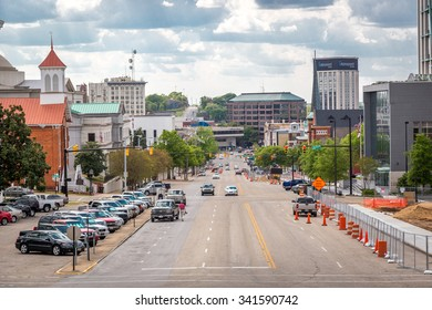Montgomery, Alabama - April 25th 2014 - Downtown Montgomery with wide street, car parked and buildings in the background. Montgomery, Alabama