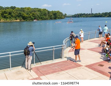 MONTGOMERY, ALABAMA - AUGUST 25, 2018:  Ninth Annual Dragon Boat Festival Photographer:  Photographer uses zoom lens to capture a race at the ninth annual Montgomery, Alabama Dragon Boat Festival.