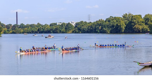 MONTGOMERY, ALABAMA - AUGUST 25, 2018:  Ninth Annual Dragon Boat Festival:  Boats taxi back to harbor after a heat at the ninth annual Montgomery, Alabama Dragon Boat Festival.