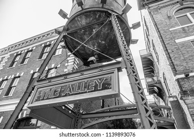 MONTGOMERY, ALABAMA - JULY 22, 2019:  Downtown Montgomery, Alabama, The Alley Black and White:   Entrance way to The Alley, all popular and ever growing hot spot area in downtown Montgomery, Alabama.