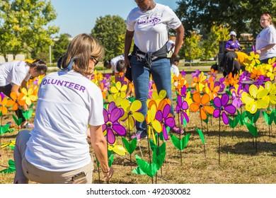 MONTGOMERY, ALABAMA - OCTOBER 01, 2016: Alzheimers Promise Garden Volunteers: Local college students and others volunteer to stage a promise garden during an Alzheimers Walkathon.