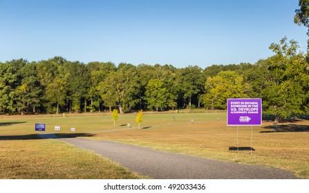 MONTGOMERY, ALABAMA - OCTOBER 01, 2016: Alzheimers Walkathon Sign An Alzheimers awareness sign along the route of an Alzheimers Awareness Walkathon.