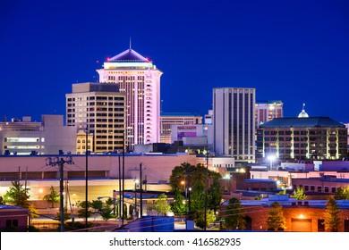 Montgomery, Alabama, USA downtown skyline at night.
