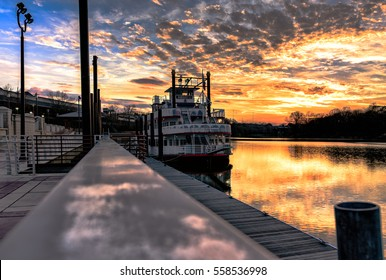 Montgomery, Alabama, USA - January 16, 2017: A view of the Harriett II Riverboat docked at Riverfront Park with a spectacular sunset over the Alabama River.