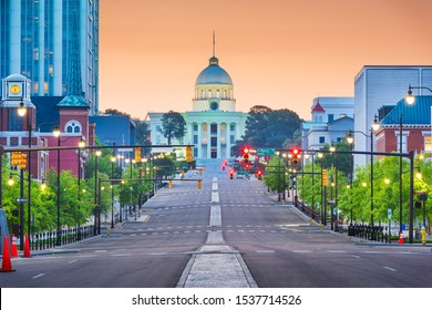 Montgomery, Alabama, USA with the State Capitol and cityscape at dawn.