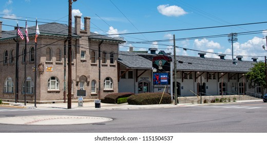 Montgomery, Alabama/USA-August 6, 2018: Banner of the Montgomery Riverwalk Stadium, built from a converted historic train shed and opened in 2004. The old train shed can be seen to the right.