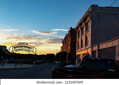 Montgomery, Alabama/USA-June 27, 2018: Sunset view of people mingling on Commerce Street near the Riverfront in Montgomery's entertainment district.