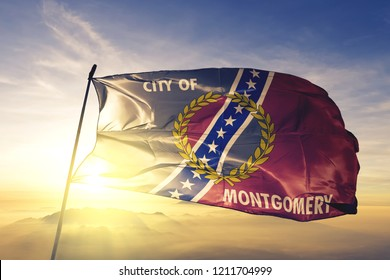 Montgomery city capital of Alabama of United States flag textile cloth fabric waving on the top sunrise mist fog