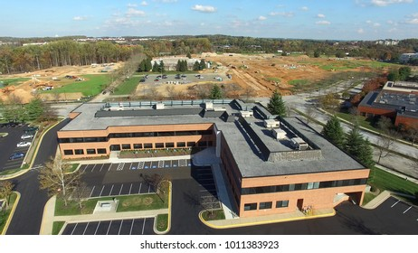 Montgomery County, Maryland - Tech Corridor Development - Aerial of Commercial Office Building with Construction Site in the Distance