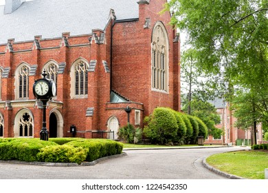 Montgomery, USA - April 21, 2018: Exterior of private liberal arts Huntingdon College building in Alabama with old, brick, historic architecture, green, clock