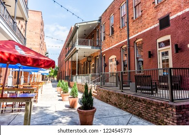 Montgomery, USA - April 21, 2018: Brick buildings restaurant on empty Alley street during day in capital Alabama city in downtown old town
