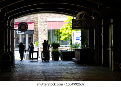 Montgomery, USA - April 21, 2018: The Alley tunnel or passage with people walking by Jimmy John's gourmet sandwich shop, Sa Za Italian restaurant in Alabama capital old town city