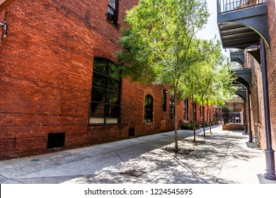 Montgomery, USA Brick buildings on Alley street alleyway during day in capital Alabama city in downtown old town historic
