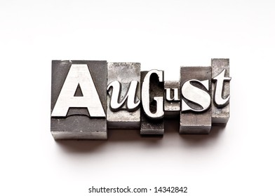 """The month of """"August"""" done in letterpress type on a white paper background. Part of a calendar series."""