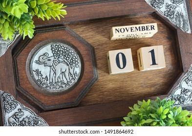 ์November month with elephant silver wooden design, Date 1.