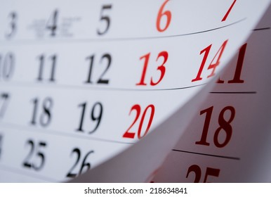 Month on a calendar viewd at an oblique angle with selective focus to the dates and numbers