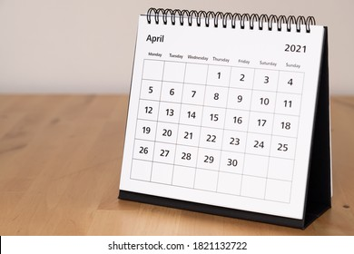 Month page: April in 2021 paper calendar on the wooden table