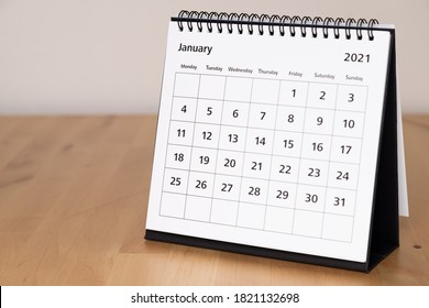 Month page: January in 2021 paper calendar on the wooden table