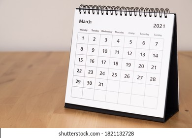 Month page: March in 2021 paper calendar on the wooden table