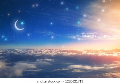 the month and the stars above the clouds in the rays of the setting sun the holy feast of Ramadan