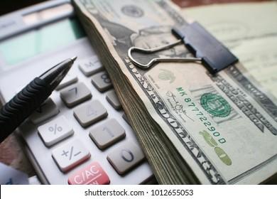 Monthly Bills With Calculator & Twenties Stock Photo