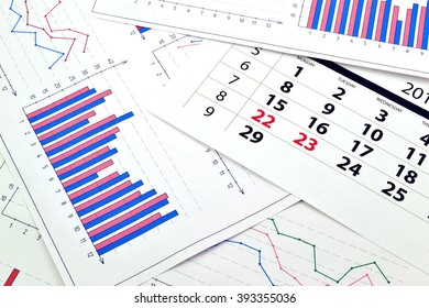 Monthly calendar and graphs on paper