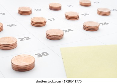 Monthly report. Empty yellow paper note in last day of month calendar with stacks euro coins. Time is money stack of coins on daily calendar pages. Plan save money to budget management. Cost of living