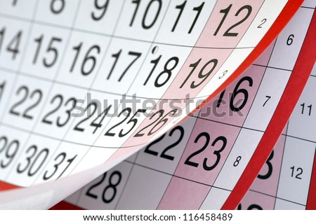 Months and dates shown on a calendar whilst turning the pages