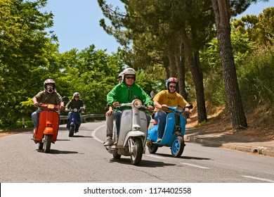 Montiano, FC, Italy - May 25, 2014: group of bikers riding vintage italian scooters Vespa and Lambretta on the italian countryside during the motorcycle rally Vespagiro