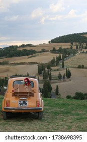 Monticchiello, Italy - 10/01/2019: Vintage wedding car in the italian countryside of Tuscany