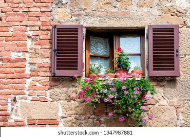 Monticchiello, Italy town or village city in Tuscany and closeup of open window shutters and pink purple flower decorations on sunny summer day nobody architecture wall