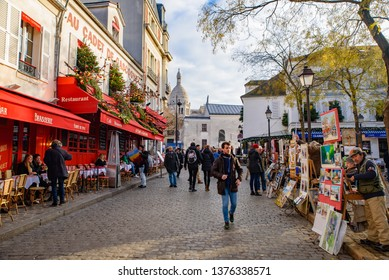 Montmartre / France - December 11 2018: The square of Place du Tertre in Montmartre, famous for artists, painters and portraitists