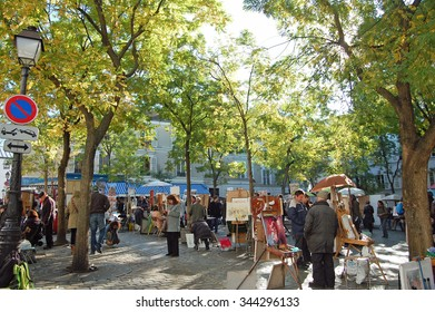 Montmartre, France - October 31, 2012: Place du Tertre in Montmartre, Paris with street artists and paintings. The area is a popular tourist attraction in Paris.