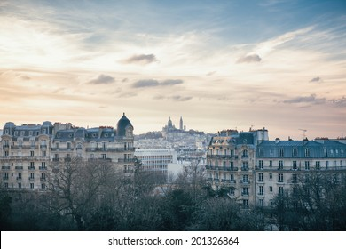 Montmartre Hill and Sacre Coeur basilica in Paris, France, seen from Buttes Chaumont Park