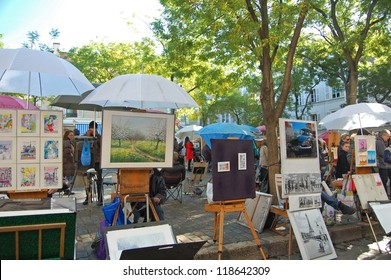 MONTMARTRE - OCTOBER 31: Artists easels and artwork set up in Place du Tertre in Montmartre, Paris on October 31, 2012. Montmartre attracted many famous modern painters in the early 20th century.