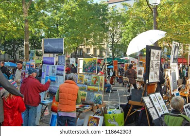 MONTMARTRE - OCTOBER 31: Place du Tertre in Montmartre, Paris with street artists and paintings on October 31, 2012. The area once attracted famous modern artists including Picasso and Dali.