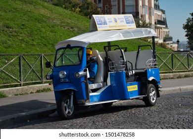 Montmartre, Paris, France - 09/02/2019:Tuktuk waiting for tourists in Montmartre