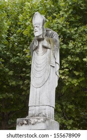 Montmartre in Paris, France - statue of the beheaded Saint Denis in a local park.  He miraculously recited mass after his beheading.