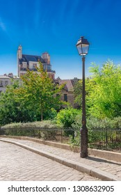 Montmartre, a very romantic parisian street with a vintage lamppost